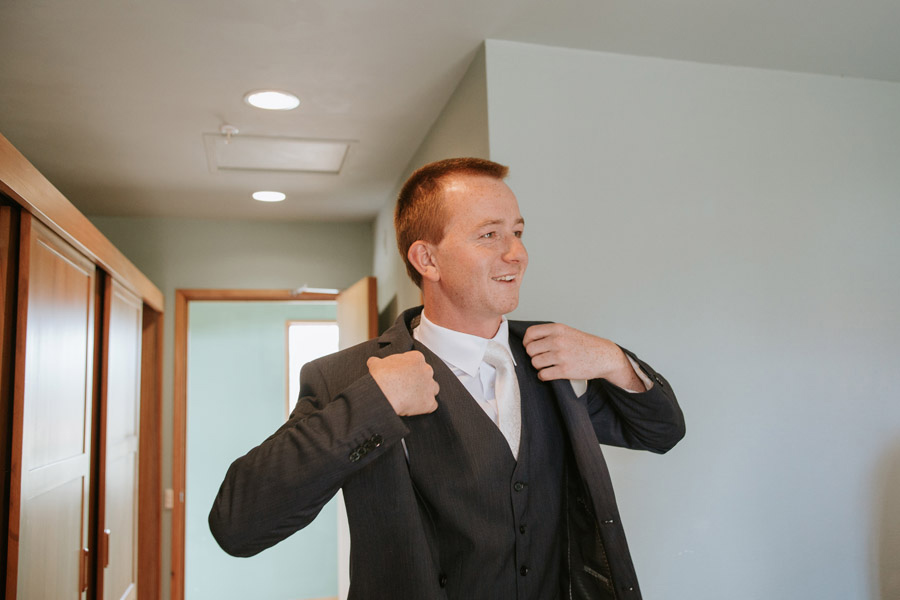 Matt, on his wedding day getting ready at Lake Ohau Lodge, captured by Lake Ohau wedding photographers Alpine Image Company.