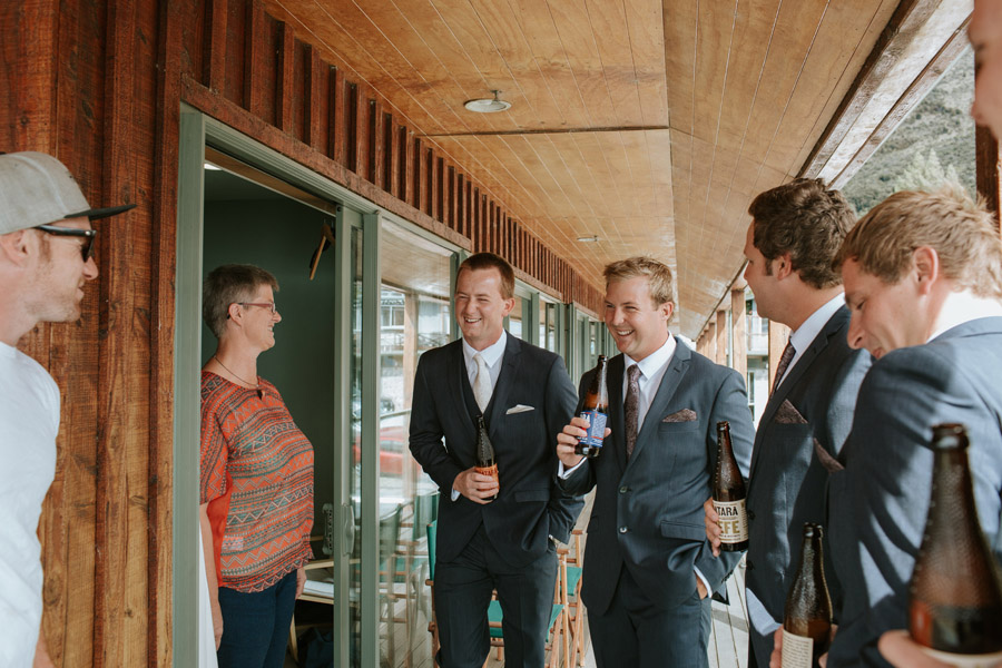The boys relaxing and getting ready for the big day ahead for Rebecca and Matt's Lake Ohau wedding photographed by Lake Ohau wedding photographers, Alpine Image Company. .