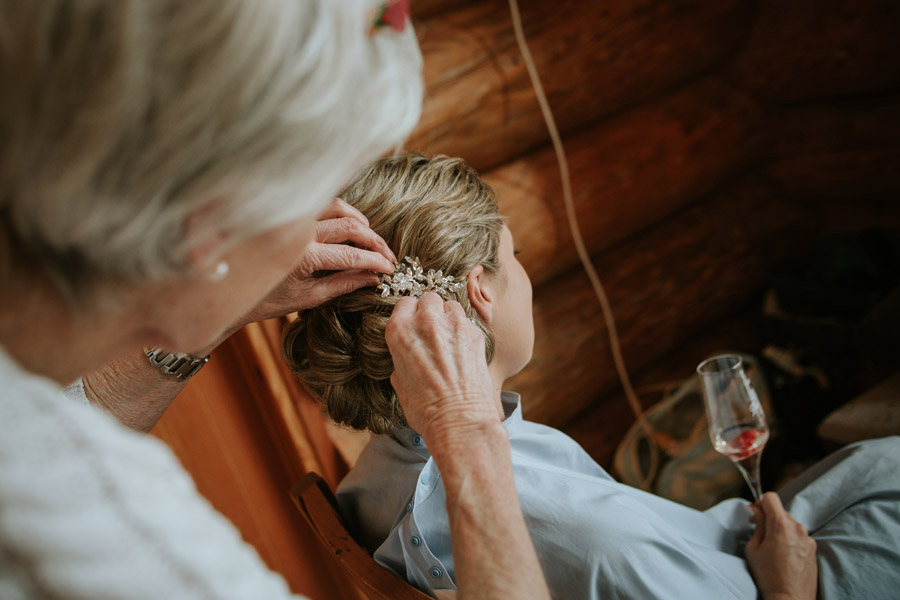 The bride getting her hair done from Rebecca and Matt's Lake Ohau destination wedding photographed by Alpine Image Company.