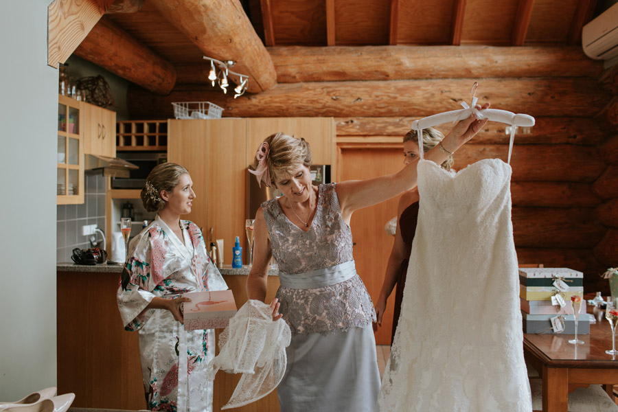 Mother of the Bride helping the bride from Rebecca and Matt's Lake Ohau wedding photographed by Queenstown wedding photographers Alpine Image Company.