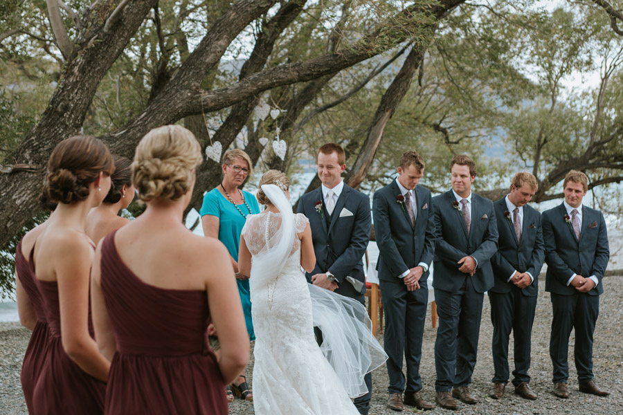 We love gorgeous and candid moments from the ceremony, as seen here captured by Wanaka wedding photographers Alpine Image Company.