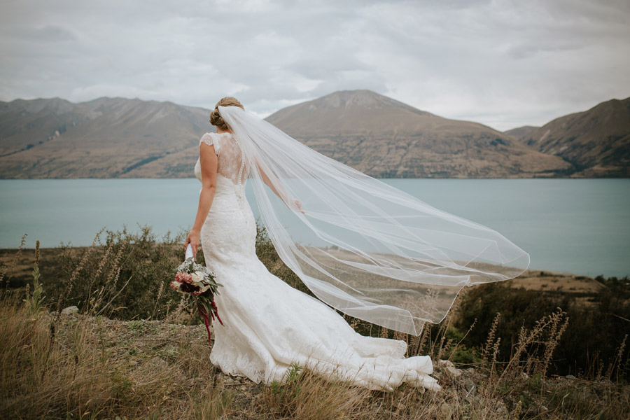Beautiful Rebecca on her Lake Ohau wedding day captured by New Zealand wedding photographers Alpine Image Company.