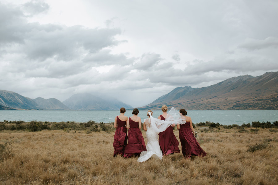 The bride and bridesmaids looking beautiful at this Lake Ohau destination wedding photographed by Wanaka wedding photographers Alpine Image Company.