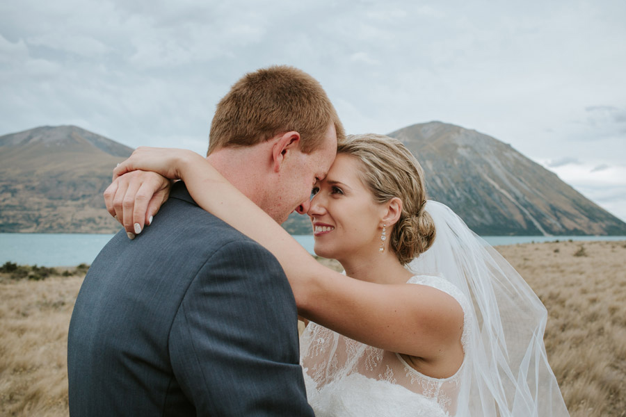A gorgeous moment of the Bride and Groom from Rebeccan and Matt's stunning Lake Ohau destination wedding captured by Wanaka wedding photographers Alpine Image Company.
