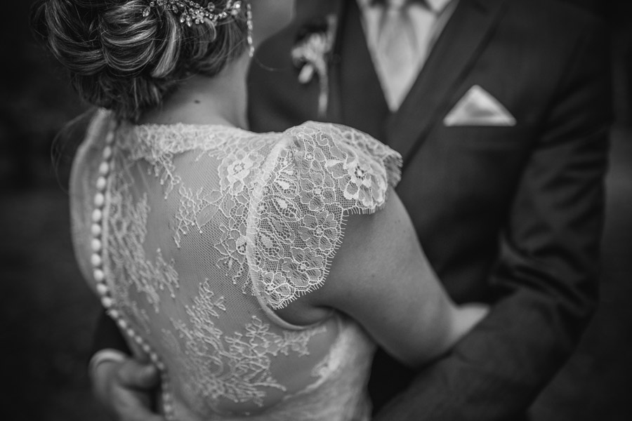 Gorgeous bridal dress details from Rebecca and Matt's Lake Ohau wedding captured by Wanaka wedding photographers Alpine Image Company.