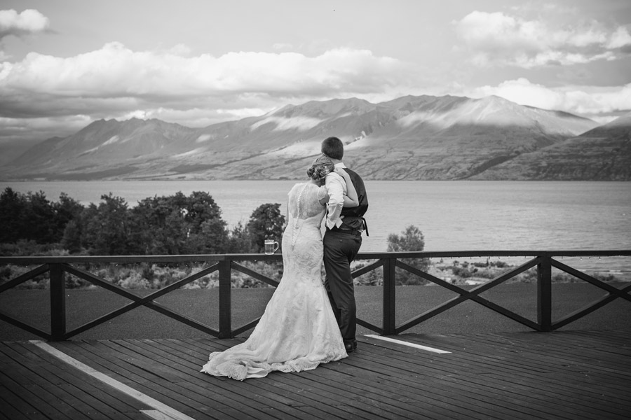 The Bride and Groom enjoying a quiet moment at their wedding at Lake Ohau Lodge, New Zealand captured by Wanaka wedding photographers Alpine Image Company.
