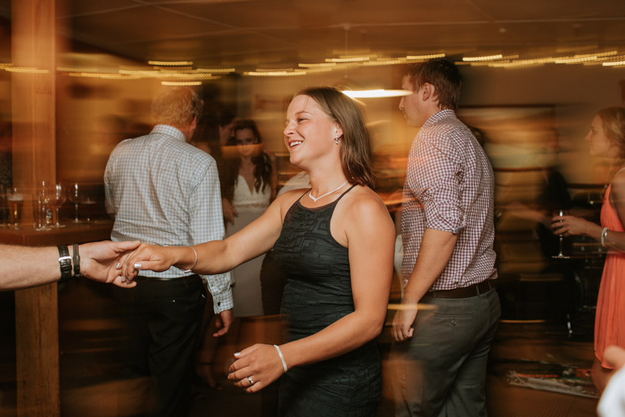 Fun reception wedding dance photos at Rebecca and Matt's Lake Ohau destination wedding captured by New Zealand wedding photographers Alpine Image Company.