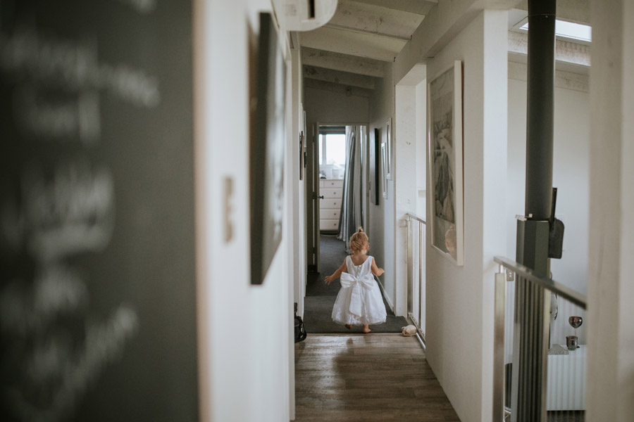 A gorgeous flower girl from Kelsey and Matt's Wanaka wedding photos captured by Wanaka wedding photographers Alpine Image Company.