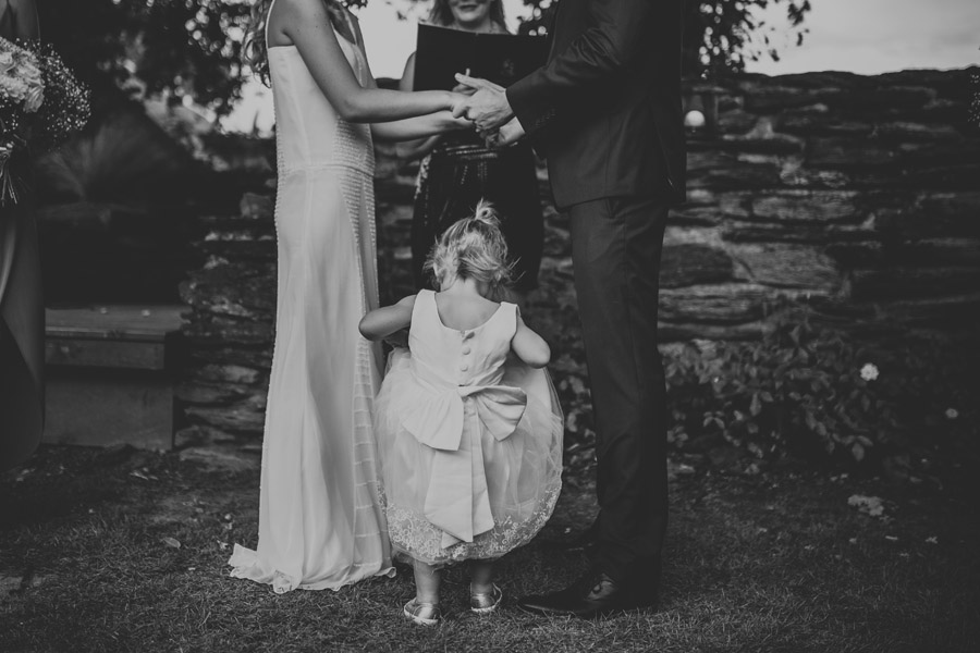 The flower girl looking so cute from Kelsey and Matt's summer wedding in Wanaka, New Zealand, captured by Wanaka wedding photographers Alpine Image Company.