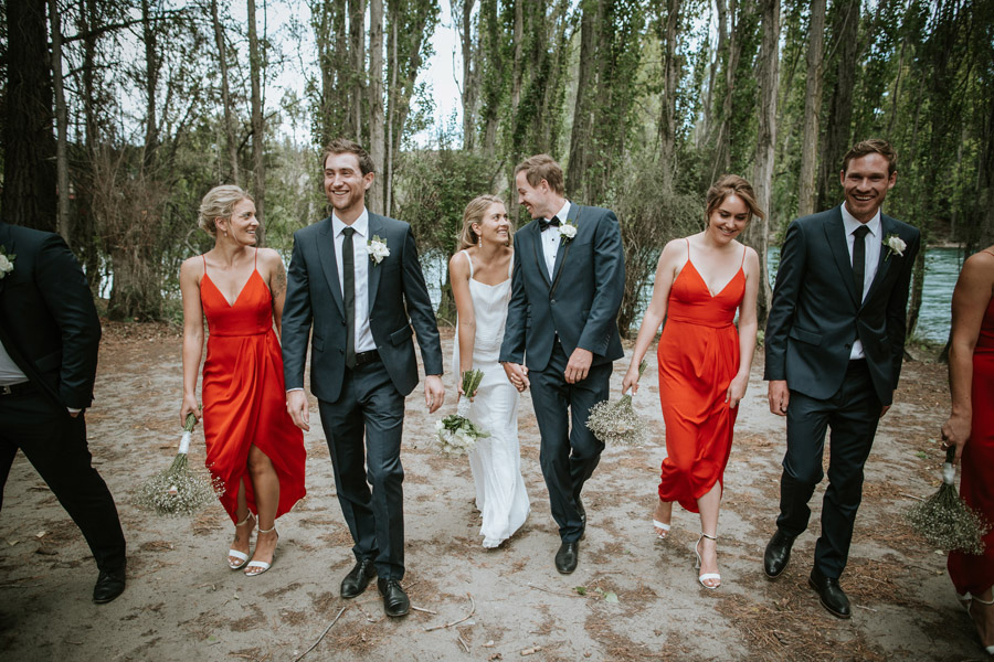 A gorgeous shot of Kelsey and Matt on their wedding day with their bridesmaids and groomsmen in Wanaka, New Zealand captured by wedding photographers Alpine Image Company.