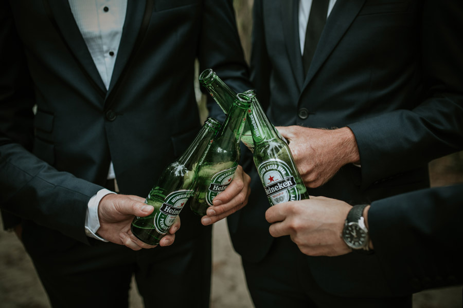 Casual groomsmen moments at Kelsey and Matt's Wanaka wedding captured by Wanaka wedding photographers Alpine Image Company.