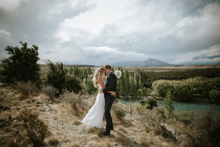 Kelsey and Matt out on their wedding day location photos in Wanaka, New Zealand. Beautiful wedding photography by Alpine Image Company.