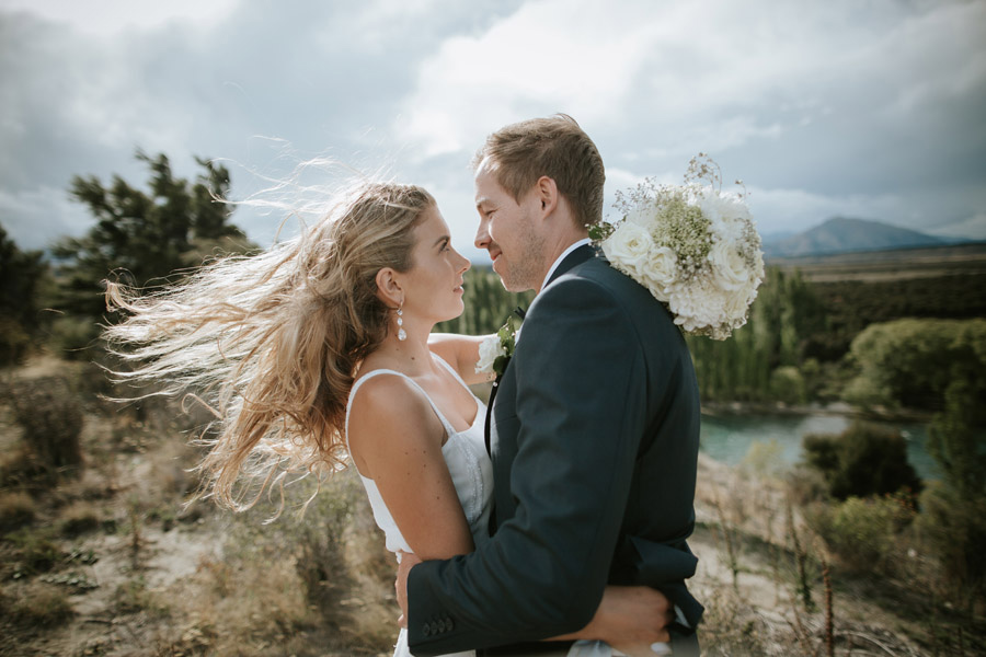 A stunning and dramatic shot of Kelsey and Matt on their wedding day in Wanaka, New Zealand photographed by Wanaka wedding photographers Alpine Image Company.