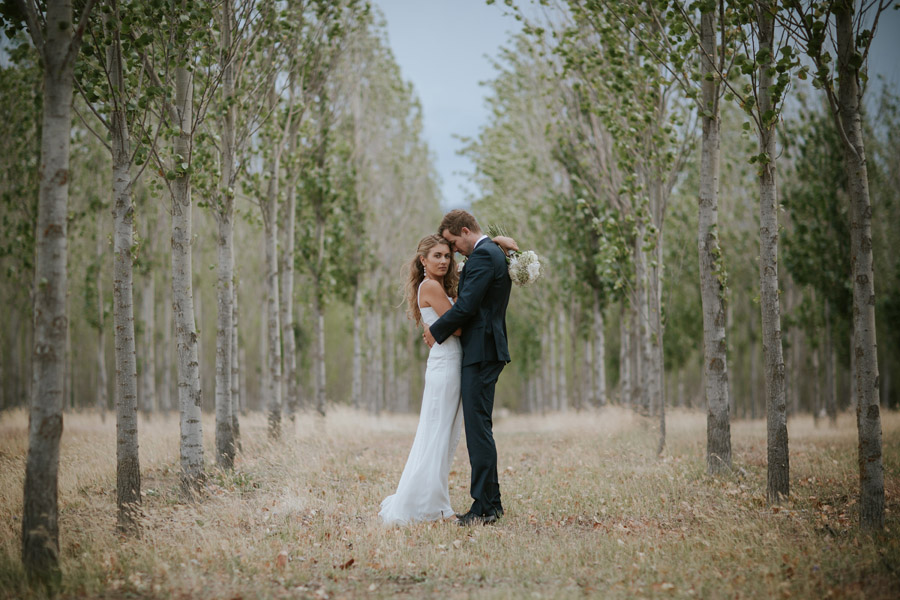 Stunning Bride and Groom portraits from Kelsey and Matt's Wanaka wedding photographed by Alpine Image Company.