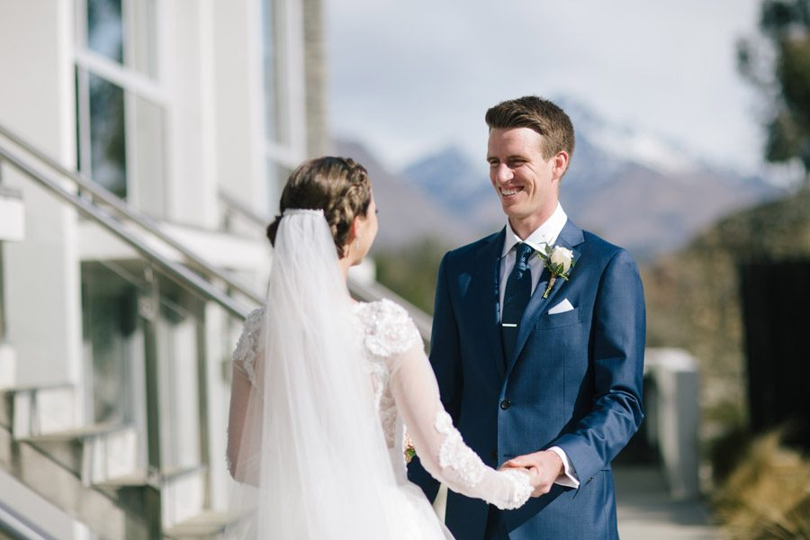 A happy groom on seeing hs beautiful bride