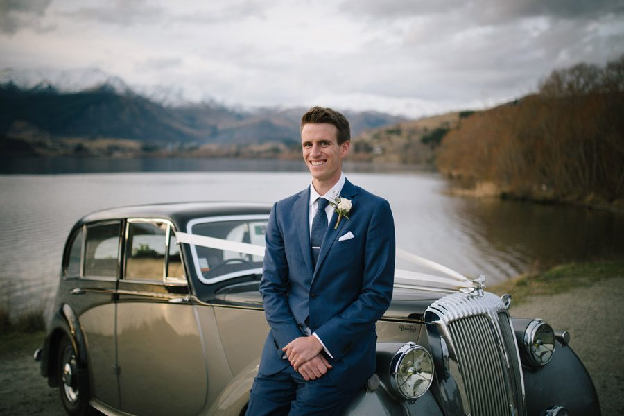 The handsome groom with his classic car