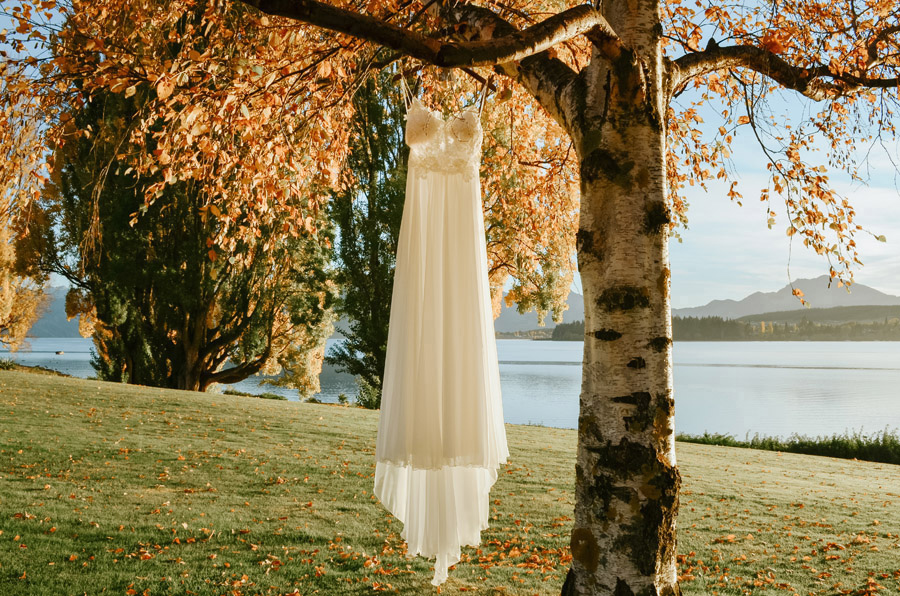 A beautiful wedding dress on this gorgeous golden autumn day in Wanaka. Photographed by Wanaka photography studio, Alpine Image Company.