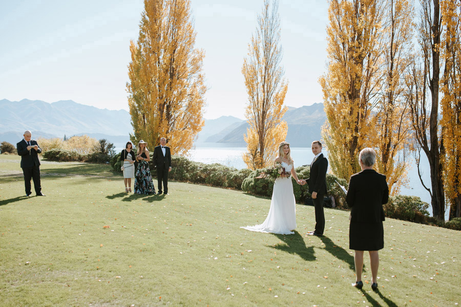 A beautiful Wanaka wedding ceremony at Edgewater Resort by Wanaka wedding photographers Alpine Image Company.