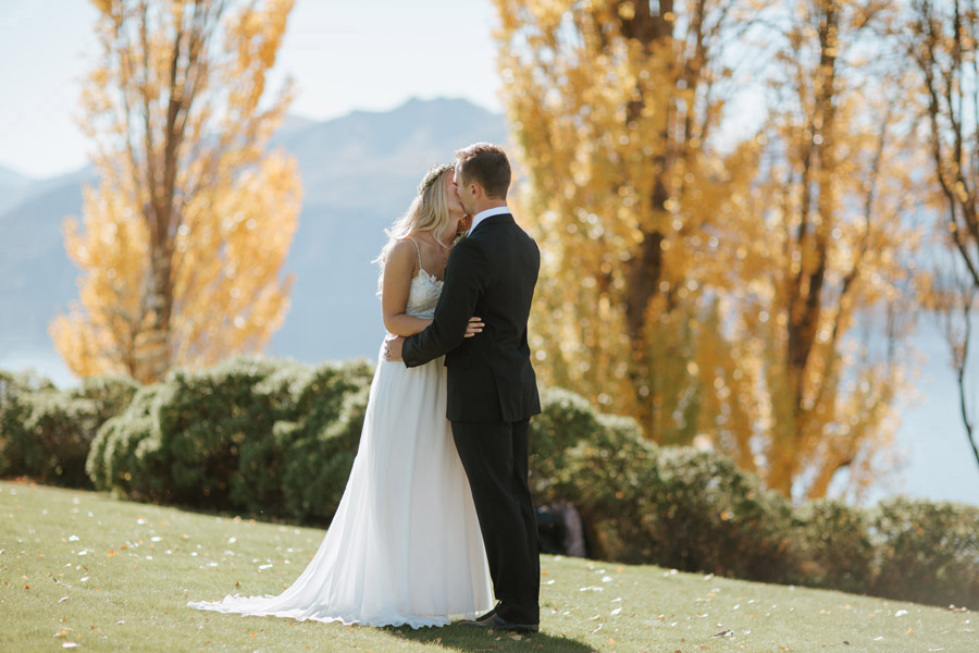 A gorgeous kiss shot of Estelle and Stas on their Wanaka wedding day photographed by Alpine Image Company.