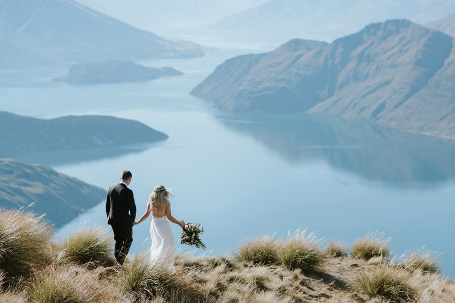 A beautiful mountaintop moment for Estelle and Stas on Mt Roy, Wanaka. Captured by Wanaka wedding photographers, Alpine Image Company.
