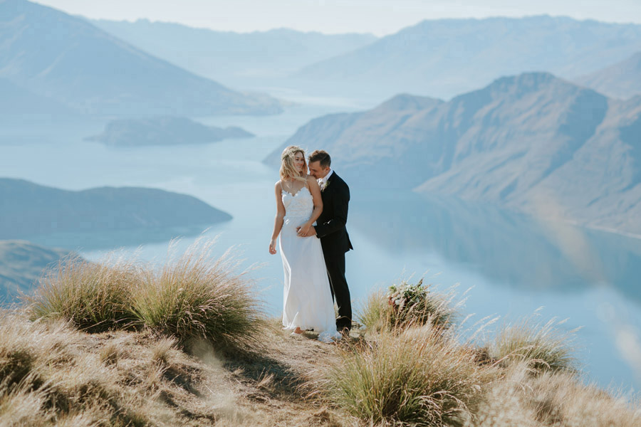 Estelle wears a stunning dress by Grace by Lace on her Wanaka wedding day, photographed by Wanaka wedding photographers, Alpine Image Company.
