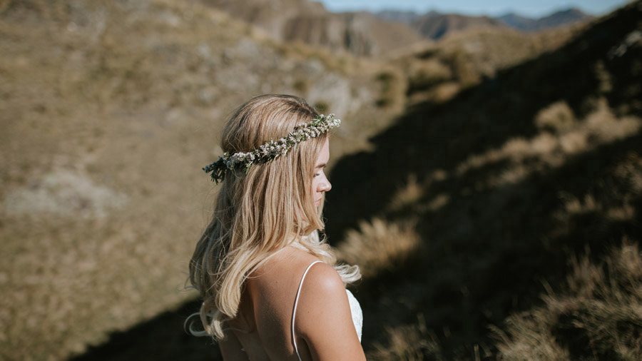 Estelle wore a simple and elegant floral crown on her Wanaka wedding day, as seen here captured by Wanaka wedding photographers Alpine Image Company.