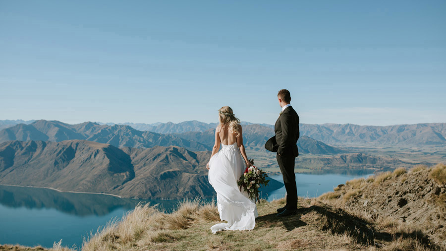 Estelle and Stas enjoying the gorgeous Wanaka view on their wedding day, captured by Wanaka wedding photographers Alpine Image Company.