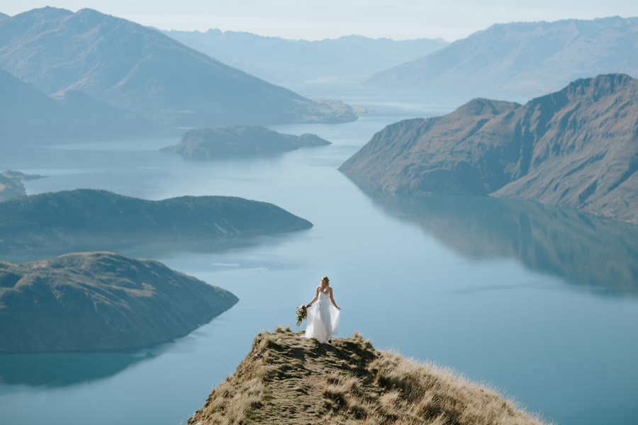 Estelle looking gorgeous on Coromandel Peak, Mount Roy in Wanaka. Photographed by Wanaka wedding photographers Alpine Image Company.