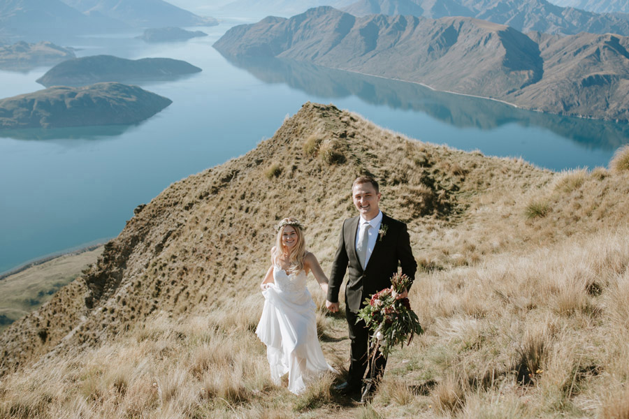 A happy Bride and Groom on their Wanaka wedding day on Coromandel Peak, Mt Roy. Photographed by Wanaka wedding photography studio, Alpine Image Company.