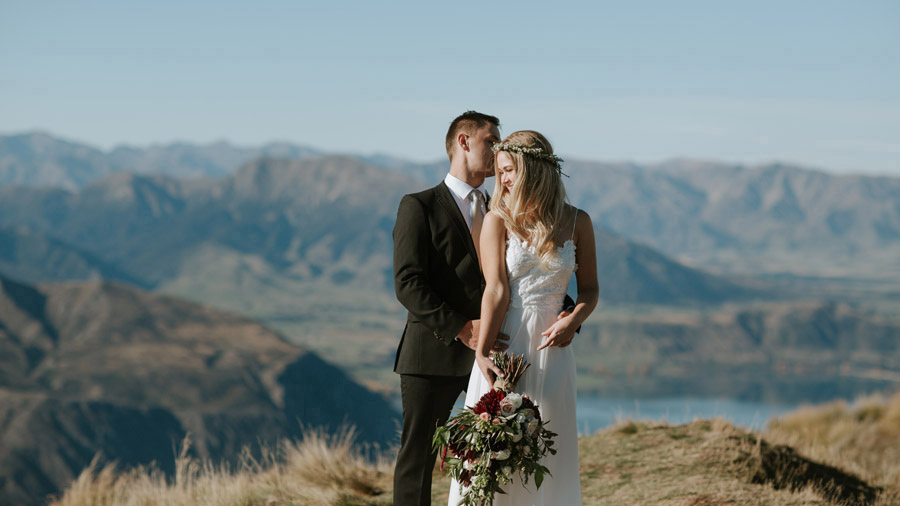 A beautiful and intimate moment of Estelle and Stas on their Wanaka wedding day, photographed by award winning wedding photographers, Alpine Image Company.