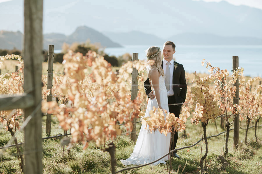 Wedding photos amongst the vines are beautiful! This is a gorgeous photo from Estelle and Stas Wanaka wedding day by Alpine Image Company.