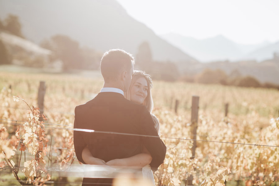 A beautiful moment of the Bride and Groom on their Wanaka wedding day photographed by Alpine Image Company.