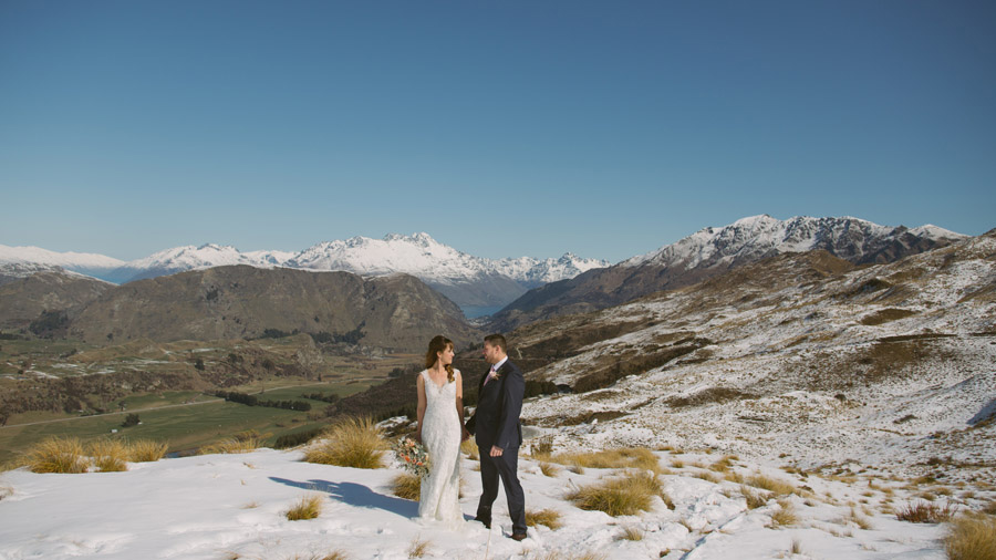 Queenstown putting on a gorgeous spring day with fresh snow for their wedding photos. Captured by Queenstown wedding photographer Alpine Image Company.