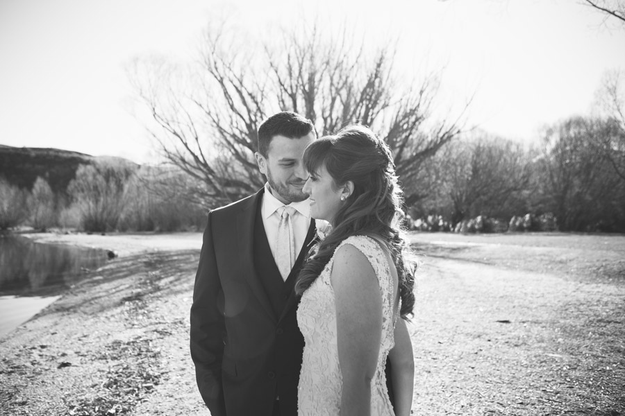 Bernard looking so in love with Katie on their Queenstown wedding day, by Wanaka wedding photographer Alpine Image Company.