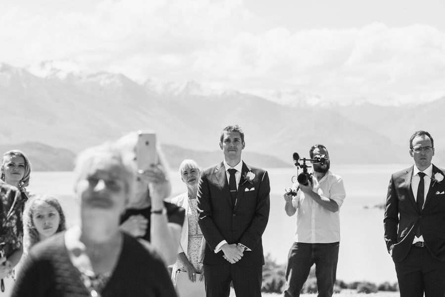 Gareth waiting anxiously for his bride to arrive to their Wanaka Wedding at The Rippon Hall, captured by Alpine Image Company