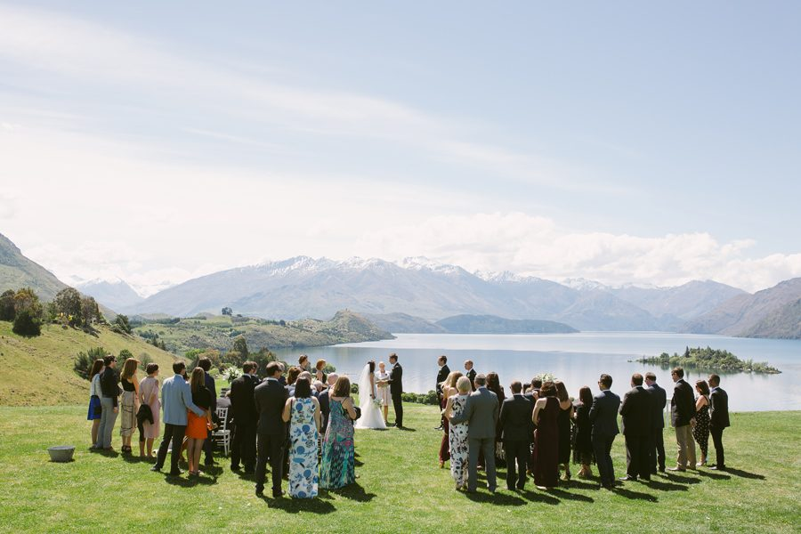 Alice and Gareth here saying their 'I do's' at The Rippon Hall, overlooking the stunning Lake Wanaka. Their wedding photography was captured by Alpine Image Company.