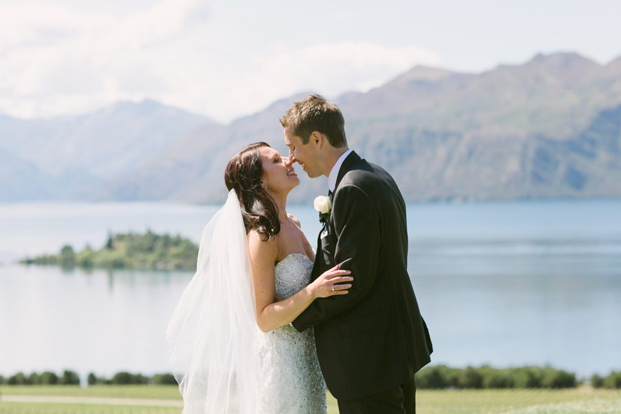 The kiss!! Alice and Gareth complete their Wanaka Wedding Ceremony in style. Photography captured by Alpine Image Company
