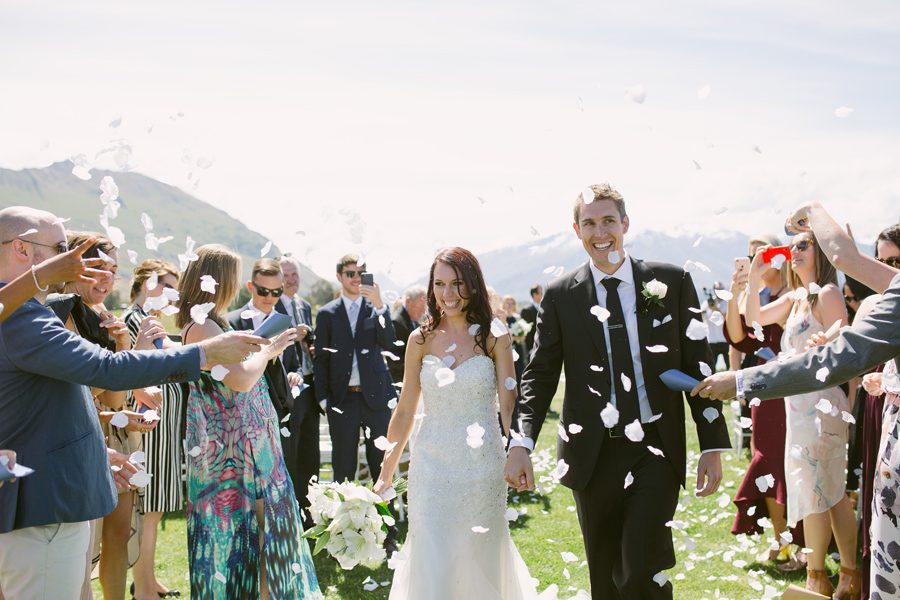 Walking down the aisle at The Rippon Hall after your incredible Wanaka Wedding has got to make you smile.... it certainly did for Alice and Gareth. Photography by Alpine Image Company