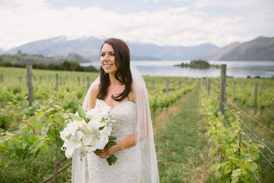 Alice looking gorgeous amoung the vines at Rippon Vineyard with photography by Alpine Image Company