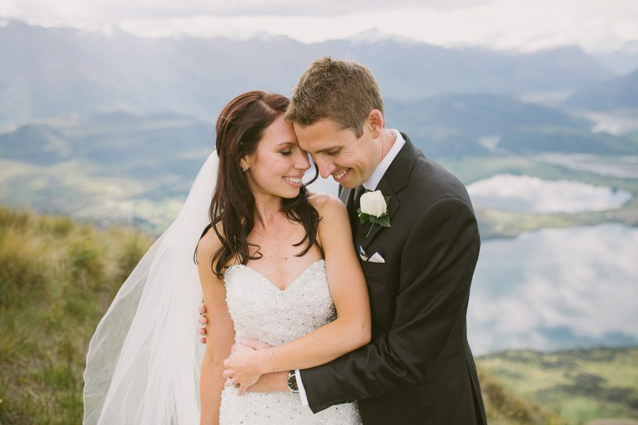 Alice and Gareth share a moment at their Wanaka wedding, high on Mount Roy with photography by Alpine Image Company