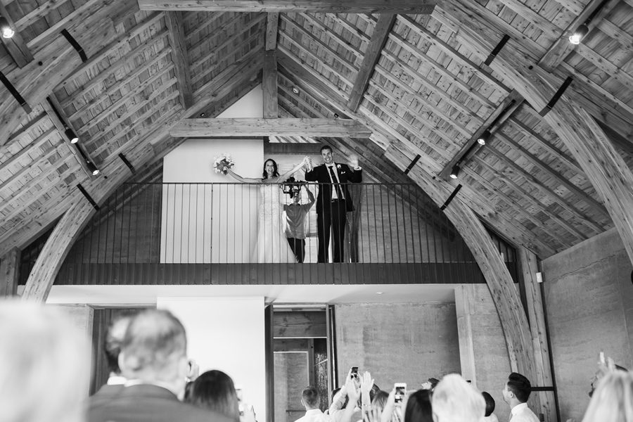 Alice and Gareth entering their reception in style at Rippon Hall. With photography by Alpine Image Company