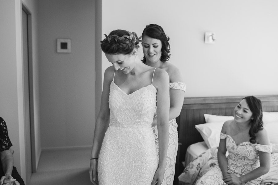 Bridesmaids helping with the final touches