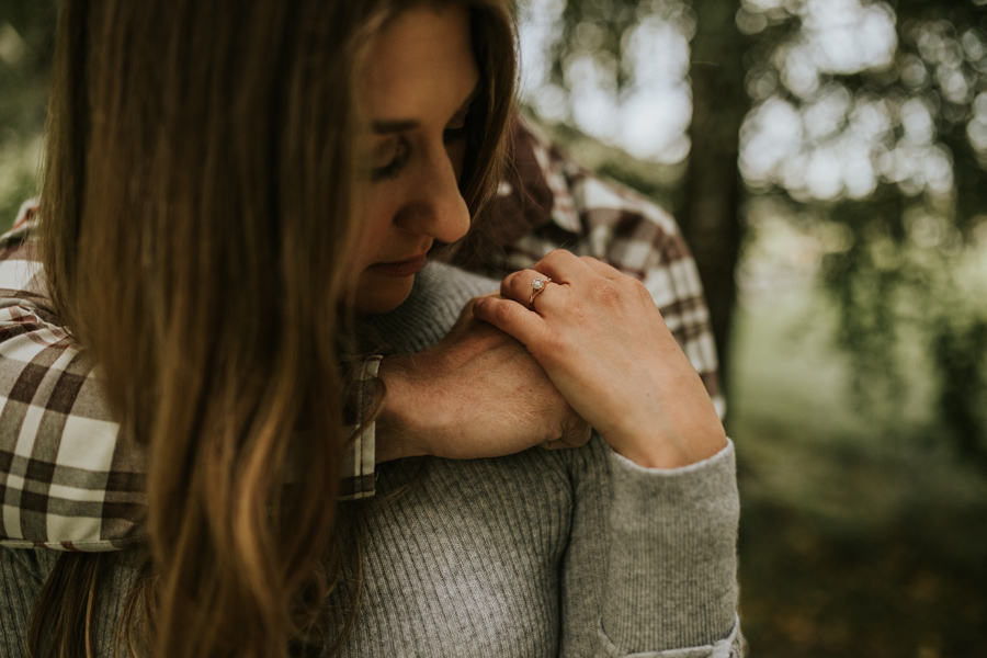 Lesley looks at her gorgeous ring on her Queenstown Engagement Shoot