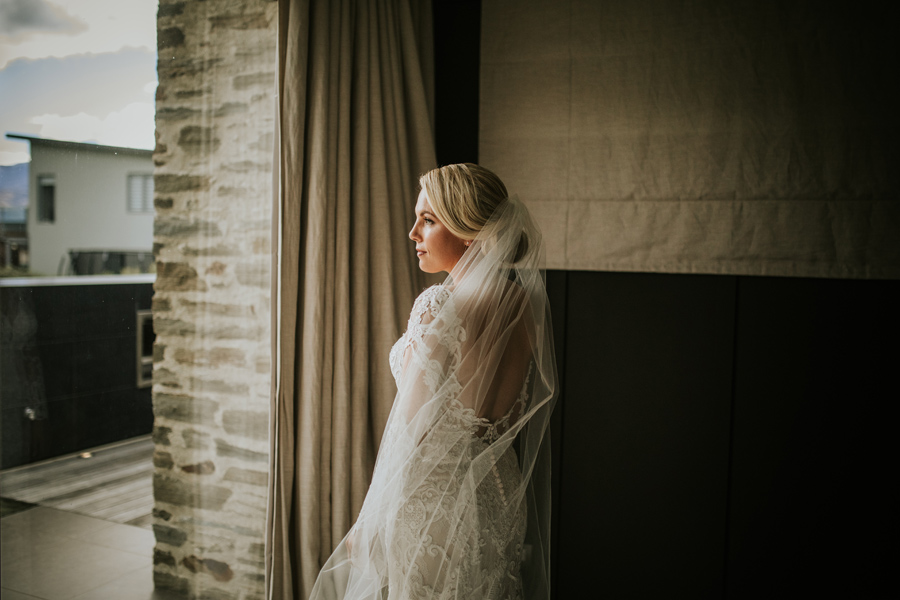 Our stunning bride Anna looking out of the window on her wedding day.