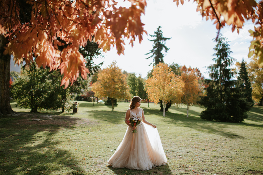 Jamie looking absolutely stunning in her wedding dress at Wanaka Station Park on her Autumn wedding day.