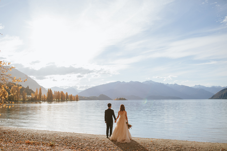 Jamie and Eric looking out at the beautiful calm lake on their Wanaka wedding day.