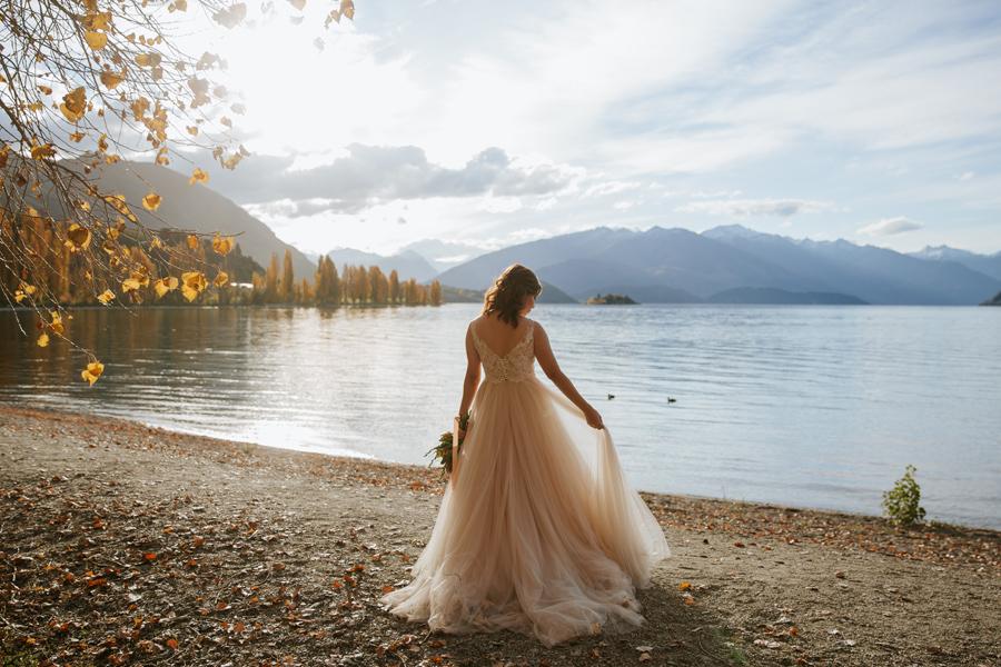 Love the autumn light coming through Jamie's dress on her Wanaka Wedding day.