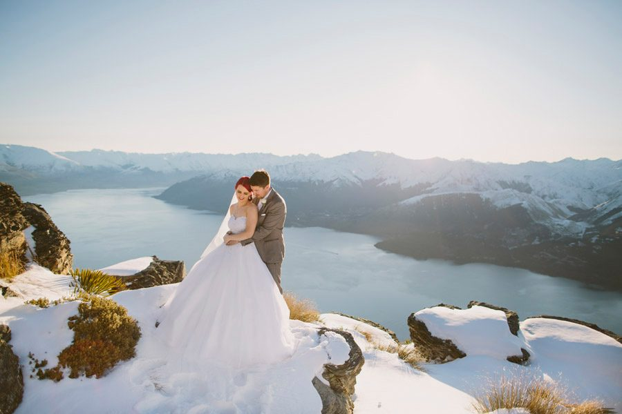 A winter wedding at it's best! A stunning photo of Louise and Brendan on snowy Cecil Peak in Queenstown on their wedding day, captured by Queenstown wedding photographers Alpine Image Company.