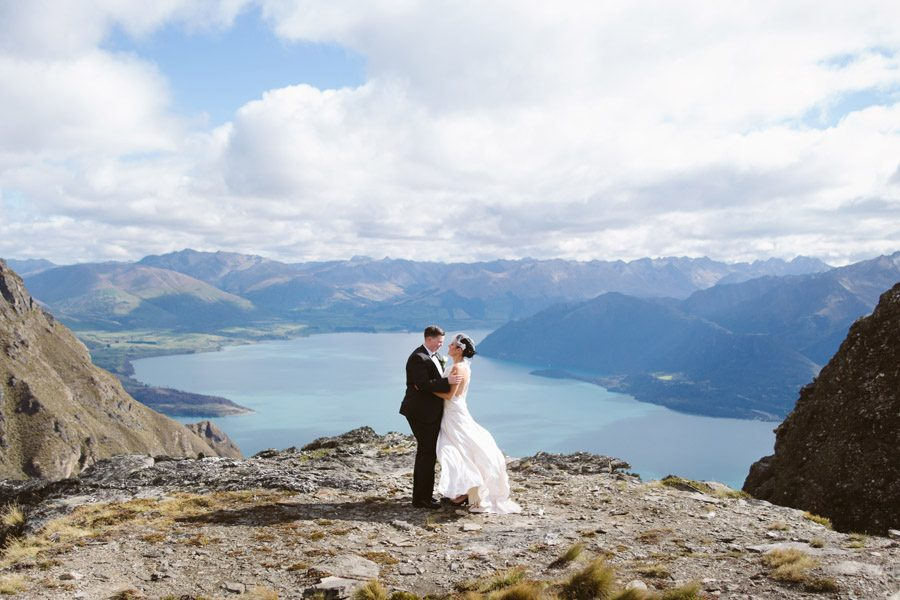 A stunning wedding photo from Kiri and Josie's beautiful Queenstown wedding on top of Cecil Peak, Queenstown taken by Queenstown wedding photographers, Alpine Image Company