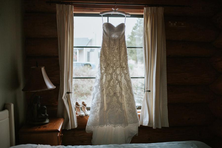 A beautiful shot of the wedding dress from Rebecca and Matt's Lake Ohau destination wedding photographed by New Zealand wedding photographers, Alpine Image Company.